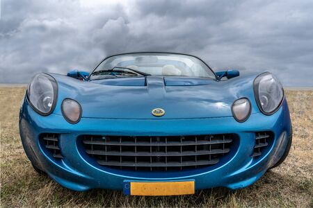 BOSSCHENHOOFDNETHERLANDS-JUNE 17, 2018: front view of a classic blue Lotus Elise at a classic car meeting