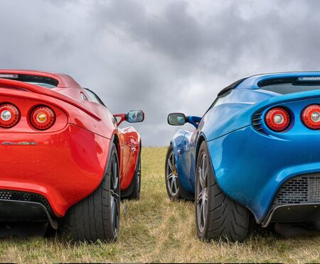 BOSSCHENHOOFDNETHERLANDS-JUNE 17, 2018: back view of two classic blue and red Lotus Elise at a classic car meeting Editorial