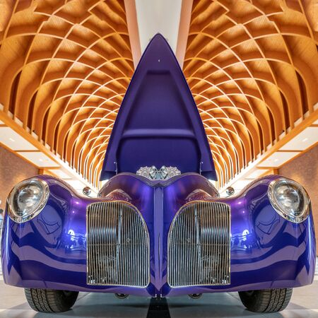 THE HAGUENETHERLANDS-JUNE 24, 2018: A spectacular purple concept car at a classic car meeting. The hood is opened for the public to see the motor.