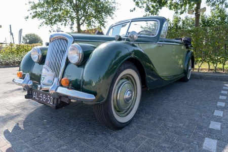 HUIZEN/NETHERLANDS-SEPTEMBER 1, 2018: a spectacular view of a rare classic Riley RDM Cabrio from 1949 at a classic car meeting
