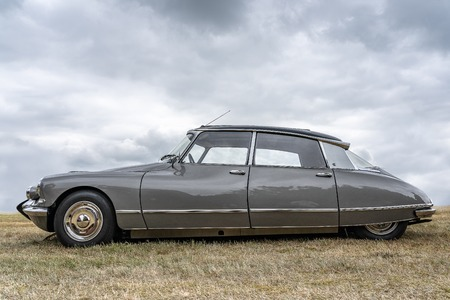 BOSSCHENHOOFDNETHERLANDS-JUNE 11, 2018: side view of a grey classic Citroen DS at a classic car meeting. This is one of the most famous french cars ever built