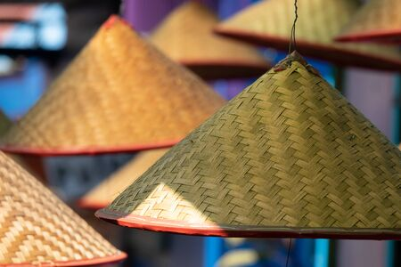Traditional bamboo hat in a conical shape. In Asia these hats are often worn as sun protection Reklamní fotografie