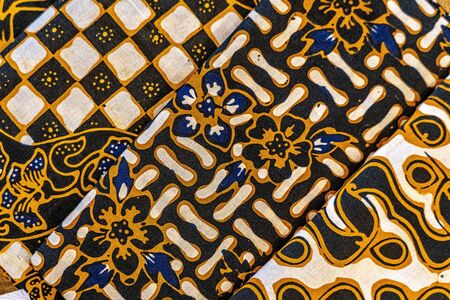 Cheerful and brightly colored batik clothing that is often found in Indonesia. Many tourists take this home as a souvenir Фото со стока