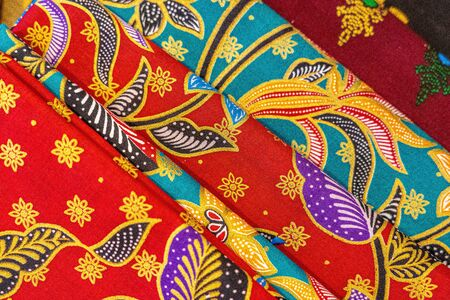 Cheerful and brightly colored batik clothing that is often found in Indonesia. Many tourists take this home as a souvenir Stockfoto