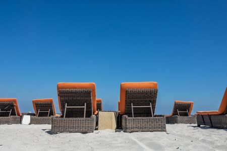 Chairs and umbrella on a beach near the sea. It gives an idyllic image that refers to the ultimate holiday feeling