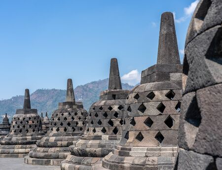 The Borobudur is a Buddhist shrine 40 km northwest of Jogjakarta in the province of Central Java, in the center of the Indonesian island of Java. Besides the Prambanan and Kraton in Jogjakarta, it is one of the main tourist attractions of Central Java Standard-Bild - 130817715