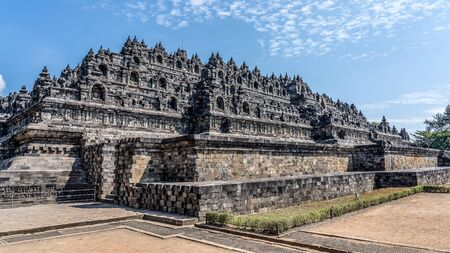 The Borobudur is a Buddhist shrine 40 km northwest of Jogjakarta in the province of Central Java, in the center of the Indonesian island of Java. Besides the Prambanan and Kraton in Jogjakarta, it is one of the main tourist attractions of Central Java Standard-Bild - 130817716