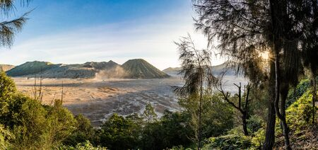 The bromo volcano on java in indonesia during the sunrise. This creates a nice warm light on the mountain