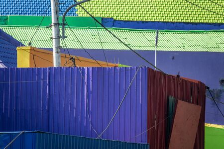 brightly colored facades and roofs of houses in a neighborhood of Malang, Indonesia. This neighborhood attracts the attention of many tourists Standard-Bild - 130817783