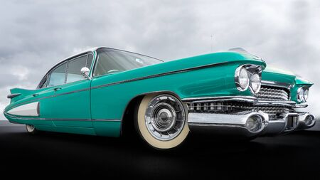 Side view of a classic american car from the fifties. The car is in excellent condition given the glossy paint and chrome. Imagens