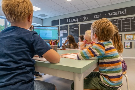 NIJMEGEN / NETHERLANDS-SEPTEMBER 13, 2019: Modern school building for children up to 12 years old. The children sit in the classroom where they receive instruction from the teacher. Editorial