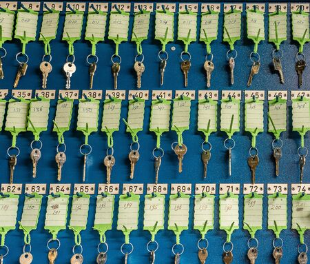 AMSTERDAM/NETHERLANDS-FEBRUARY 24: A row of old keys to lockers hanging on the blue wall and have green labels on them