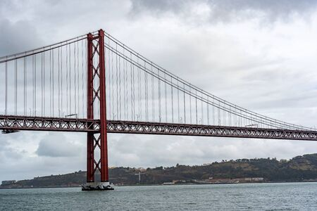 Red steel cable stayed bridge over water