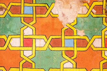 Weathered Moroccan ornaments in wall and floor in vibrant colors
