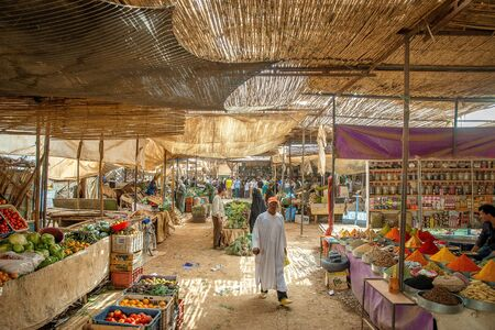 OUARZAZATE/MOROCCO - APRIL 19 2017: People at a typical Moroccan market in the desert Stock Photo