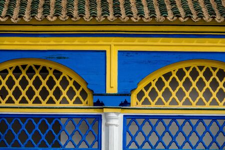 Moorish architecture in yellow and blue colors and arch Reklamní fotografie