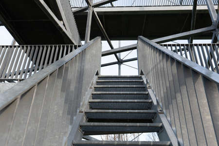 Construction of a steel staircase of a watchtower at the port of Rotterdam overlooking the river and the port
