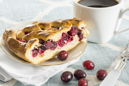 slice of fresh baked,sweet cranberry pie,served on the kitchen table Banco de Imagens