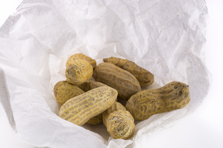 Closeup bunch of peanuts on a white paper napkin