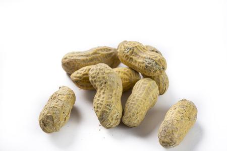 Closeup bunch of peanuts on a white background Reklamní fotografie