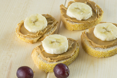 Closeup of peanut butter and banana sandwich on a wood. Stock Photo