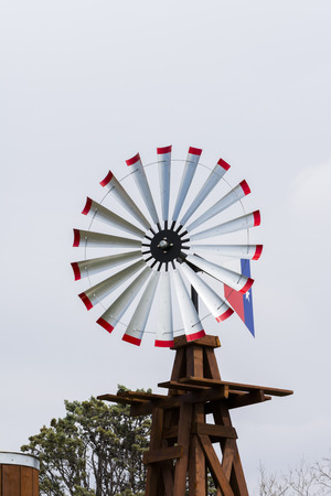 wind mill: Vintage wind mill with wood water storage tank.