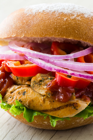 Chicken barbecue sandwich with vegetables.