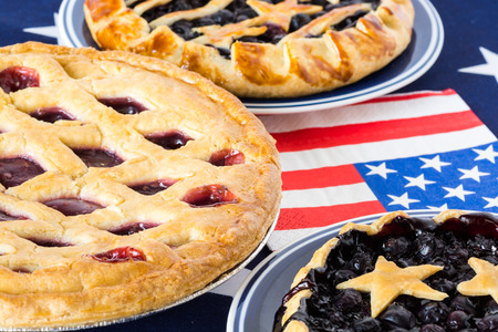 Closeup of homemade, fresh baked blueberry pies and triple berry pie. Imagens