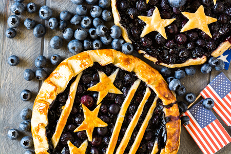 Closeup of homemade, fresh baked blueberry pies.