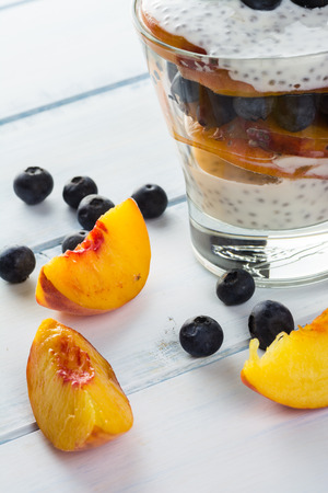 parfait: Close up of  peach, blueberry chia seed parfait.