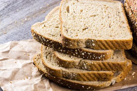 whole grain: Close up of cut whole grain bread on a wood. Stock Photo