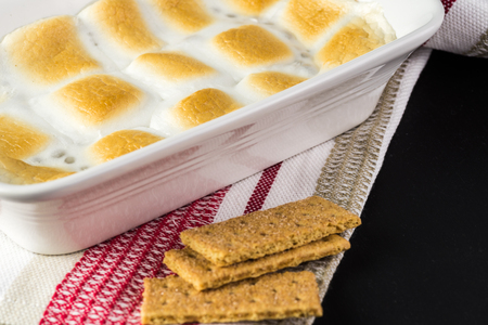 casserole dish: Close up of fresh cooked smores dip in casserole dish. Stock Photo