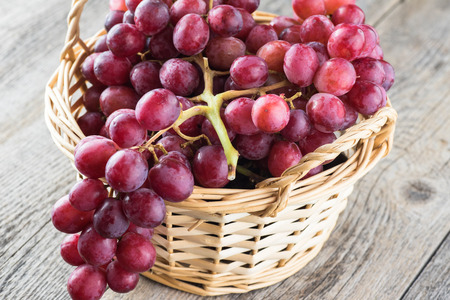 grape: Close up of red grapes in a basket.
