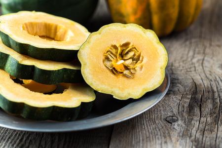 Close up of cut acorn squash on a plate.