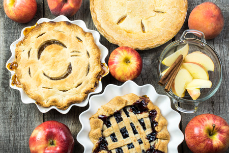 Close up of fresh baked, homemade apple, mix berry, peach pies.
