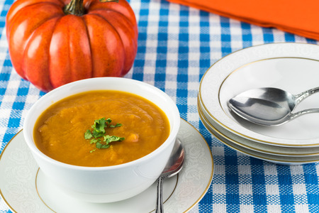 Close up of bowl with pumpkin soup.