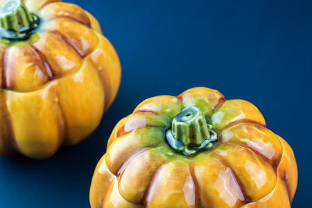 Close up of two pumpkin shaped bowls with lid.
