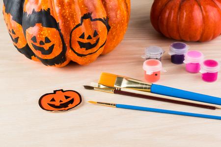 pumpkin: Close up of painting a pumpkin for Halloween.