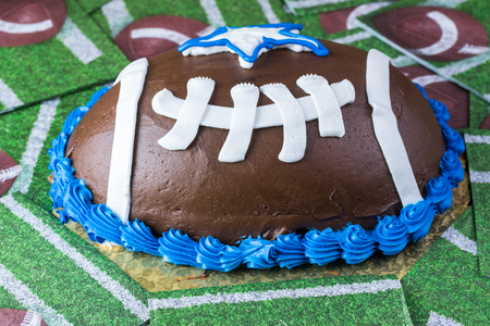 Close up of football shaped butter cream cake. Imagens
