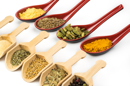 Close up of assorted spices on white background. Zdjęcie Seryjne
