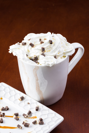 chocolate curls: Close up of mug of hot chocolate with  chocolate curls and whipped cream.