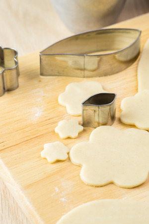 cookie cutter: Close up of cut crust with metal cookie cutter for cranberry pie.