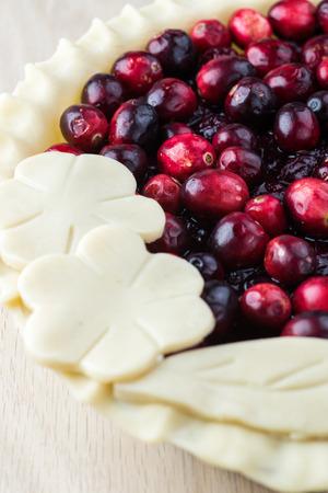 prepared: Close up of prepared for oven cranberry pie. Stock Photo