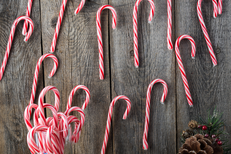 Close up of Christmas decoration with candy cane garland.