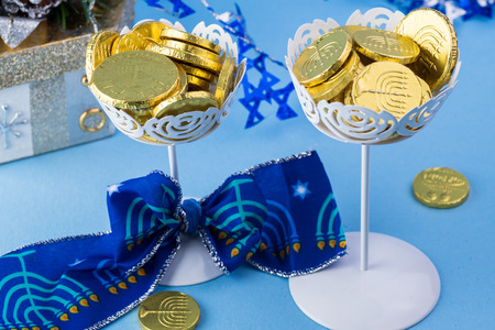 gelt: Close up of chocolate Hanukkah gelt coins in vases and gift box.
