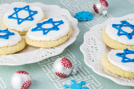 hanuka: Close up of cookies decorated with blue stars -  Hanukkah symbol on a white plate.