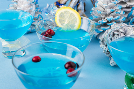 hanuka: Close up of glasses with blue cocktail and Hanukkah decoration.