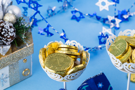 hanukkah: Close up of chocolate Hanukkah gelt coins in vases and gift box.