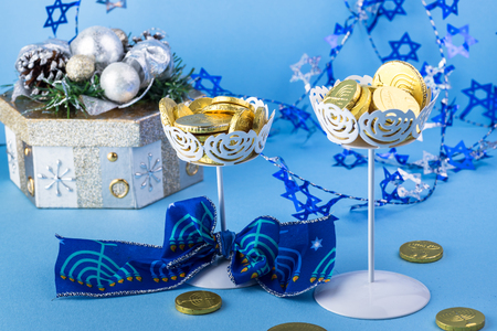 hanuka: Close up of chocolate Hanukkah gelt coins in vases and gift box.