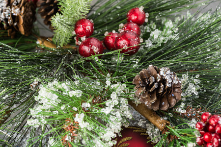 close up of christmas tree decoration with pine cones berries and ice stock photo - Christmas Tree With Pine Cones